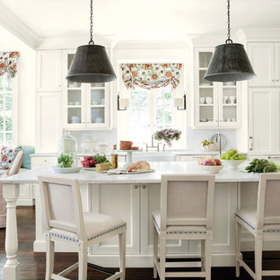 Inspiration for a timeless eat-in kitchen remodel in Atlanta with a farmhouse sink, recessed-panel cabinets, white backsplash, subway tile backsplash, marble countertops and white cabinets