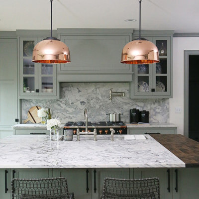 Example of a small transitional l-shaped medium tone wood floor and brown floor eat-in kitchen design in Other with an undermount sink, shaker cabinets, green cabinets, gray backsplash, an island, gray countertops, marble countertops, marble backsplash and stainless steel appliances