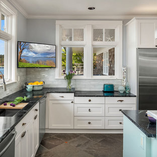 Inspiration for a large beach style open plan kitchen in Seattle with an undermount sink, shaker cabinets, soapstone benchtops, glass tile splashback, stainless steel appliances, slate floors, with island, green floor and green benchtop.