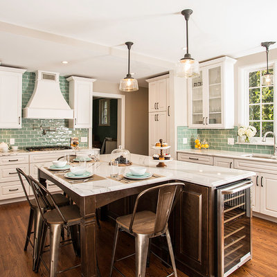 Example of a large transitional u-shaped medium tone wood floor eat-in kitchen design in Detroit with a double-bowl sink, raised-panel cabinets, white cabinets, quartz countertops, blue backsplash, ceramic backsplash, stainless steel appliances and an island