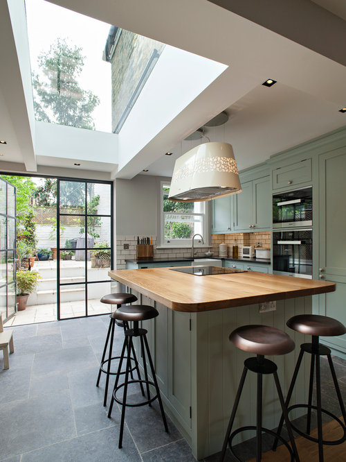 Kitchen with green cabinets design ideas remodel for Traditional kitchen extensions