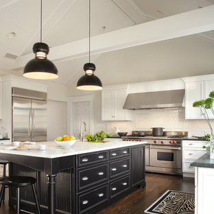 Eat-in kitchen - large transitional u-shaped dark wood floor and brown floor eat-in kitchen idea in New York with recessed-panel cabinets, white cabinets, white backsplash, subway tile backsplash, stainless steel appliances, a single-bowl sink, marble countertops and an island