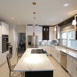 Design ideas for a mid-sized transitional u-shaped separate kitchen in DC Metro with a farmhouse sink, shaker cabinets, white cabinets, quartz benchtops, multi-coloured splashback, stainless steel appliances, porcelain floors, with island, beige floor and multi-coloured benchtop.