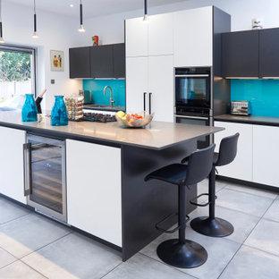 White and Carbon Matt Kitchen with Aqua Splashback