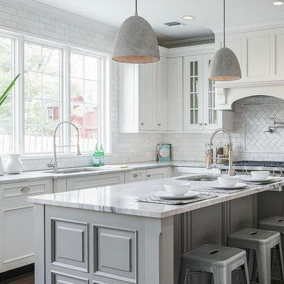 Example of a large classic l-shaped dark wood floor and brown floor kitchen design in New York with an undermount sink, white cabinets, white backsplash, subway tile backsplash, an island, gray countertops and recessed-panel cabinets