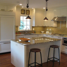 Modern Kitchen by DeRhodes Construction