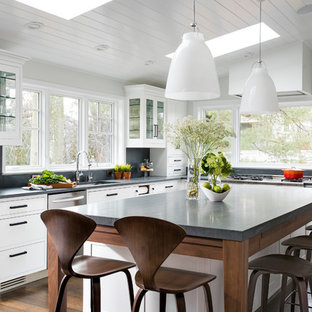 Design ideas for a large transitional l-shaped eat-in kitchen in New York with a single-bowl sink, shaker cabinets, white cabinets, limestone benchtops, grey splashback, stone slab splashback, stainless steel appliances, medium hardwood floors and with island.