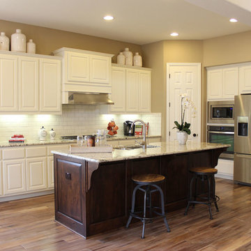 White cabinets - dark stained island by Burrows Cabinets