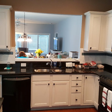 White Cabinets with Black Handles and Appliances