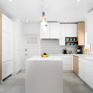 This is an example of a medium sized scandi l-shaped enclosed kitchen in Salt Lake City with a submerged sink, flat-panel cabinets, white cabinets, engineered stone countertops, white splashback, ceramic splashback, white appliances, cement flooring, an island, grey floors and yellow worktops.