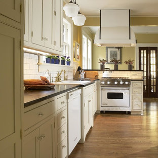 Traditional kitchen ideas - Kitchen - traditional kitchen idea in Atlanta with a drop-in sink, shaker cabinets, beige cabinets, white backsplash, subway tile backsplash and white appliances