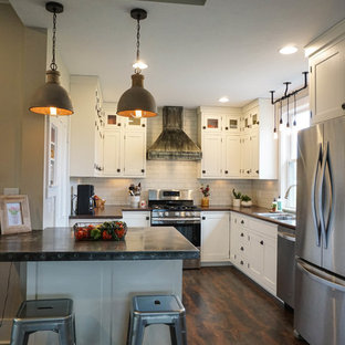 Small farmhouse u-shaped kitchen pantry in Columbus with a built-in sink, shaker cabinets, white cabinets, white splashback, metro tiled splashback, stainless steel appliances, dark hardwood flooring, an island, brown floors and zinc worktops.