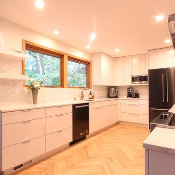 White Flat Cabinets, Herringbone Wood Floor, Quartz Countertops