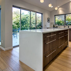 Midcentury Kitchen by Bill Fry Construction - Wm. H. Fry Const. Co.