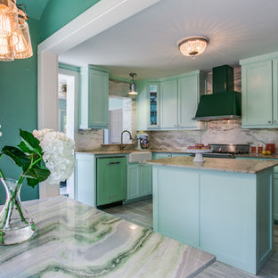 This is an example of a small eclectic l-shaped eat-in kitchen in Dallas with a farmhouse sink, shaker cabinets, green cabinets, quartzite benchtops, green splashback, stone slab splashback, coloured appliances, ceramic floors and with island.