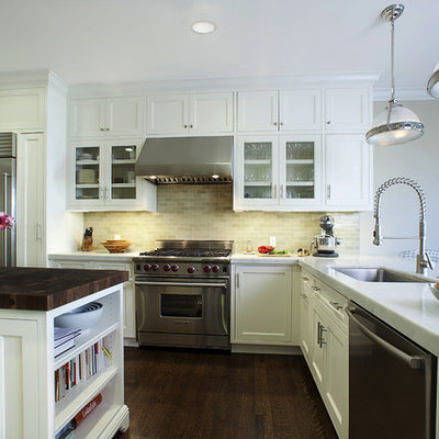 Elegant l-shaped kitchen photo in San Francisco with glass-front cabinets, marble countertops, stainless steel appliances, a single-bowl sink, white cabinets, gray backsplash and ceramic backsplash