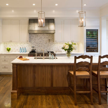White Kitchen Cabinets with Calacatta Oro Marble Island