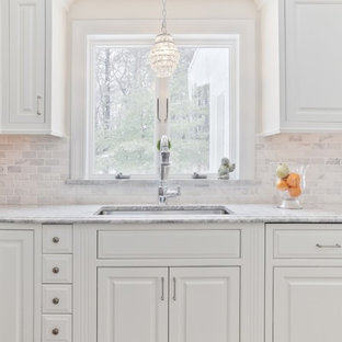 Traditional kitchen photos - Inspiration for a timeless kitchen remodel in Boston with a single-bowl sink, raised-panel cabinets, white cabinets, white backsplash and marble backsplash