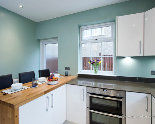 White Kitchen dark worktops with Duck Egg Blue walls
