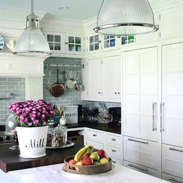 white kitchen marble countertop, sub zero, wood countertop