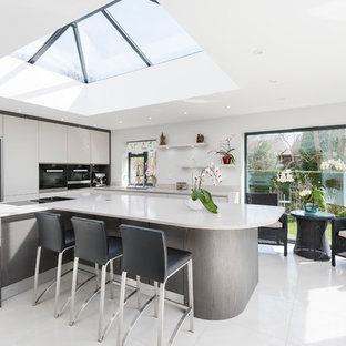 White kitchen with bespoke curved island