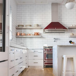 Large contemporary kitchen appliance - Inspiration for a large contemporary l-shaped plywood floor kitchen remodel in Houston with flat-panel cabinets, white cabinets, marble countertops, white backsplash, porcelain backsplash, colored appliances and an island
