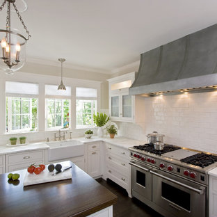 Large traditional eat-in kitchen designs - Large elegant u-shaped dark wood floor eat-in kitchen photo in New York with a farmhouse sink, wood countertops, beaded inset cabinets, white cabinets, white backsplash, ceramic backsplash, an island and stainless steel appliances