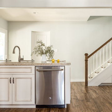 White Kitchen with Hardwood Flooring and Stainless Steel Appliances