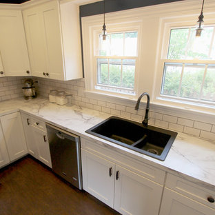 Mid-sized transitional kitchen pantry remodeling - Kitchen pantry - mid-sized transitional galley linoleum floor kitchen pantry idea in Cleveland with an undermount sink, flat-panel cabinets, white cabinets, white appliances and no island