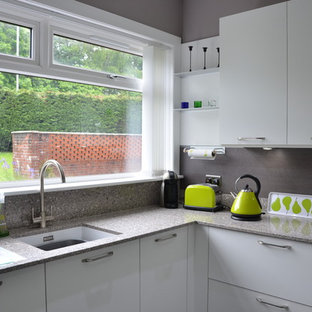 Inspiration for a mid-sized contemporary u-shaped eat-in kitchen in Glasgow with a double-bowl sink, open cabinets, grey cabinets, granite benchtops, grey splashback, marble splashback, coloured appliances, medium hardwood floors, no island and brown floor.