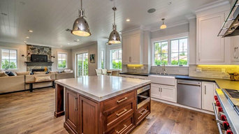 White Kitchen with White Cabinets & Wood Cabinets Island
