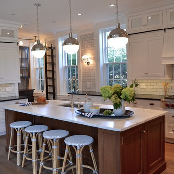 White Kitchen with Wood Floor and Quarter Sawn Oak Island with White Countertop