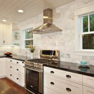 Inspiration for a traditional kitchen in San Diego with stainless steel appliances, granite benchtops, white splashback and marble splashback.