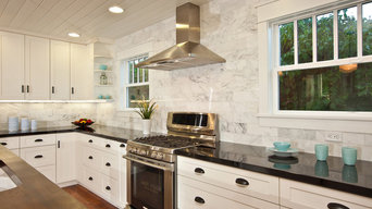 White Kitchen with wood island, carrara backsplash, black granite