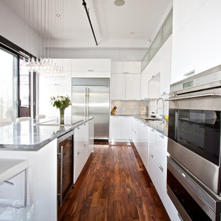 Minimalist kitchen photo in Montreal with stainless steel appliances