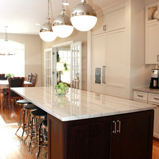 Contemporary eat-in kitchen ideas - Inspiration for a contemporary l-shaped eat-in kitchen remodel in Philadelphia with a farmhouse sink, shaker cabinets, white cabinets, quartzite countertops, white backsplash and stainless steel appliances