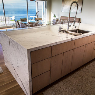 Inspiration for a mid-sized contemporary single-wall eat-in kitchen in Santa Barbara with an undermount sink, louvered cabinets, marble benchtops, white splashback, matchstick tile splashback, limestone floors and with island.