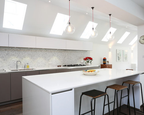 Inspiration for a contemporary single-wall dark wood floor kitchen remodel  in London with mosaic