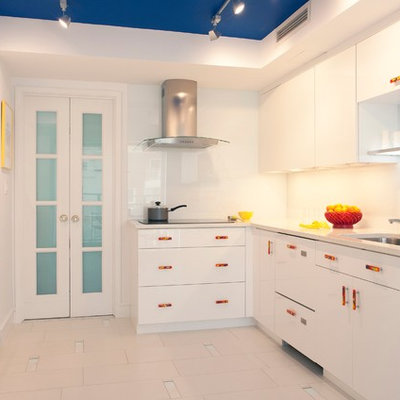 Kitchen - eclectic kitchen idea in Boston with a single-bowl sink, flat-panel cabinets, white cabinets, white backsplash and white appliances
