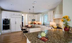 White Raised Panel Brookhaven Cabinet Kitchen with Granite Countertops