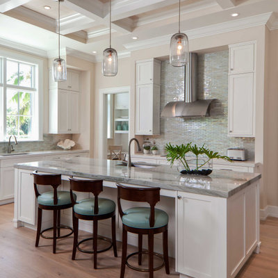 Large transitional light wood floor, beige floor and coffered ceiling kitchen photo in Tampa with shaker cabinets, white cabinets, granite countertops, metallic backsplash, an island, gray countertops, an undermount sink and mosaic tile backsplash