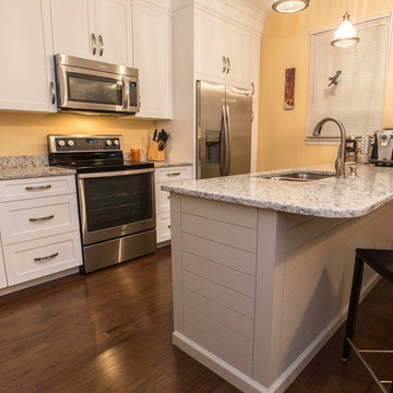 White Shaker Style Kitchen Cabinets with Shiplap Style Island