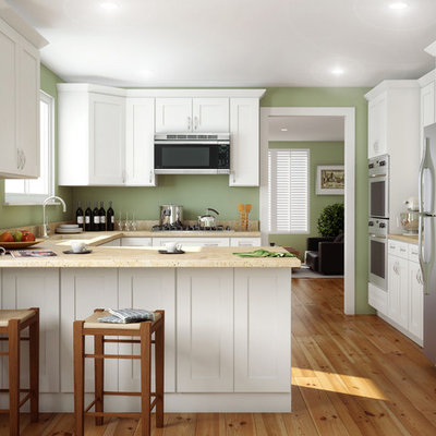 Mid-sized arts and crafts u-shaped light wood floor and beige floor kitchen photo in Other with shaker cabinets, white cabinets, stainless steel appliances, a peninsula, an undermount sink and quartz countertops