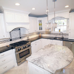 Small classic u-shaped kitchen pantry in St Louis with a submerged sink, raised-panel cabinets, white cabinets, granite worktops, stainless steel appliances, marble flooring and an island.