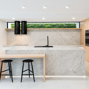 Inspiration for a large modern l-shaped kitchen in Brisbane with light wood cabinets, marble benchtops, marble splashback, stainless steel appliances, marble floors, with island, white floor, a drop-in sink, flat-panel cabinets, grey splashback and grey benchtop.