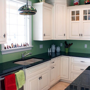 Inspiration for a large traditional u-shaped eat-in kitchen in New York with an undermount sink, beaded inset cabinets, white cabinets, granite benchtops, stainless steel appliances, ceramic floors and with island.