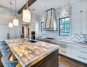 White transitional kitchen with backlit island
