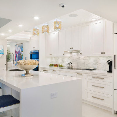 Large trendy single-wall porcelain tile and white floor open concept kitchen photo in Miami with an undermount sink, shaker cabinets, white cabinets, marble countertops, multicolored backsplash, marble backsplash, stainless steel appliances, an island and white countertops