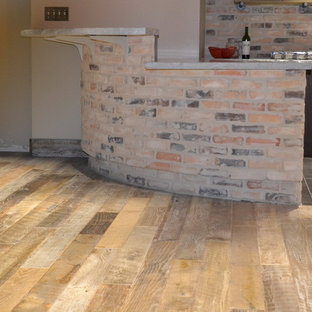 Mid-sized rustic eat-in kitchen appliance - Example of a mid-sized mountain style u-shaped light wood floor eat-in kitchen design in Austin with flat-panel cabinets, brown cabinets, multicolored backsplash, stone slab backsplash, stainless steel appliances and a peninsula