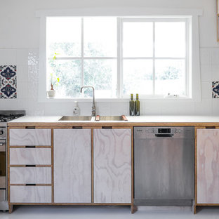 Inspiration for a contemporary l-shaped kitchen in Melbourne with a drop-in sink, beaded inset cabinets, light wood cabinets, white splashback and stainless steel appliances.